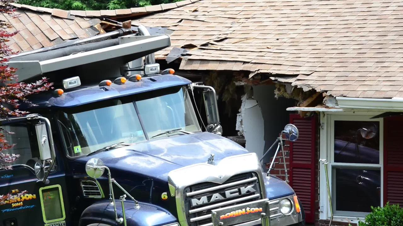 A dump truck hits a house in Hawthrone, no injuries reported.