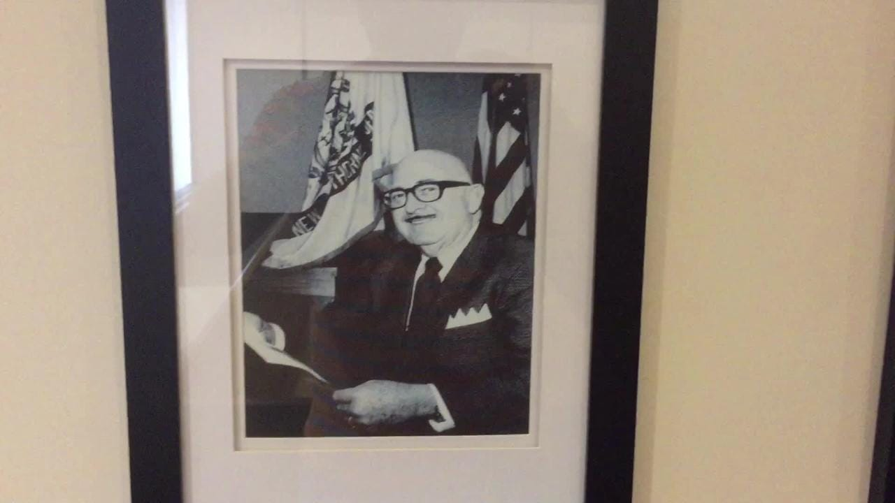 Hawthorne Mayor Richard Goldberg talks about portraits of the borough's mayors, a display that was recently unveiled in the municipal courtroom.