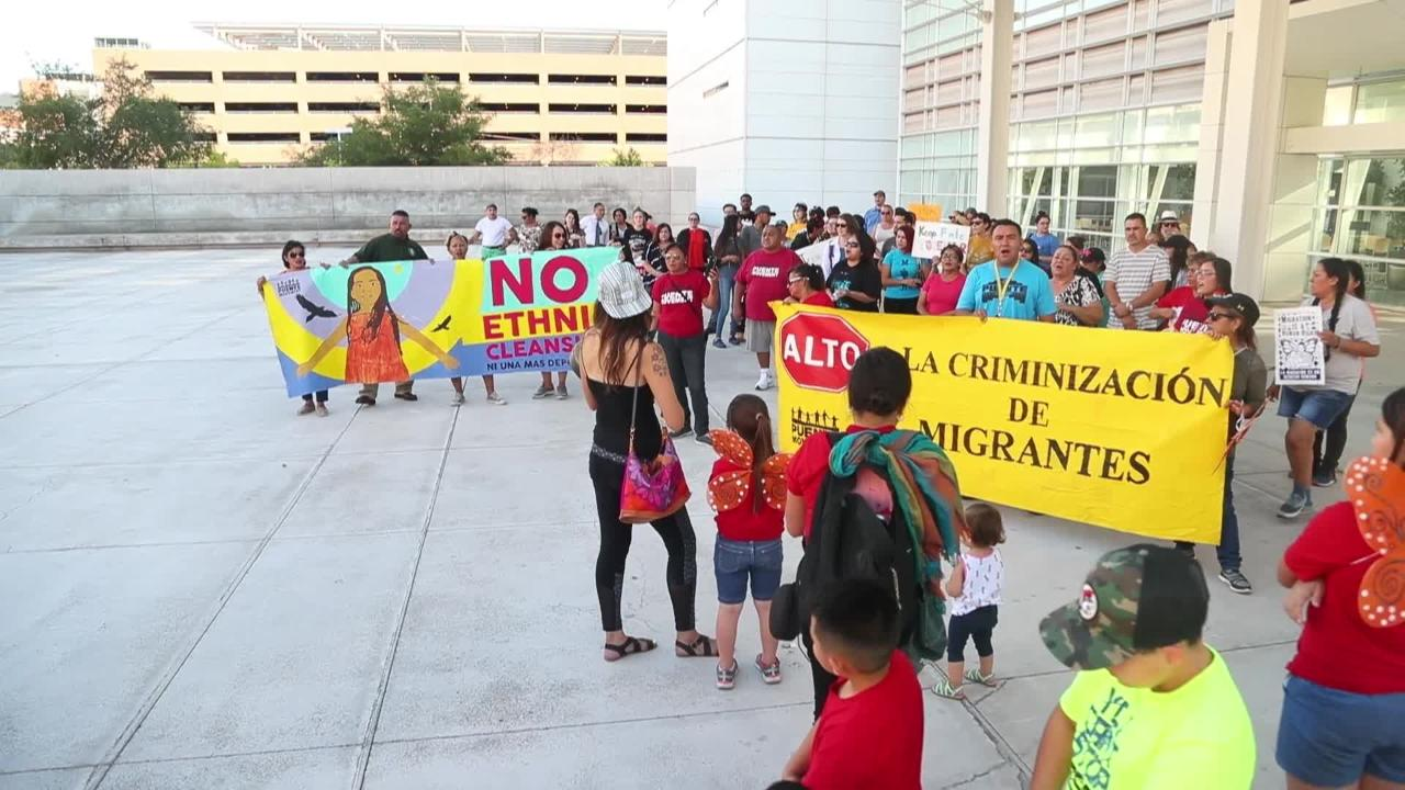 People gather outside the Sandra Day O'Connor Courthouse to oppose President Trump's zero-tolerance policy.