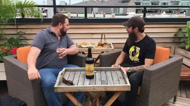Beer columnist Robert Allen and HopCat beer program manager Jay Poljanac are tasting a new Founders tiki-inspired beer called Barrel Runner at HopCat Royal Oak's third-floor balcony.