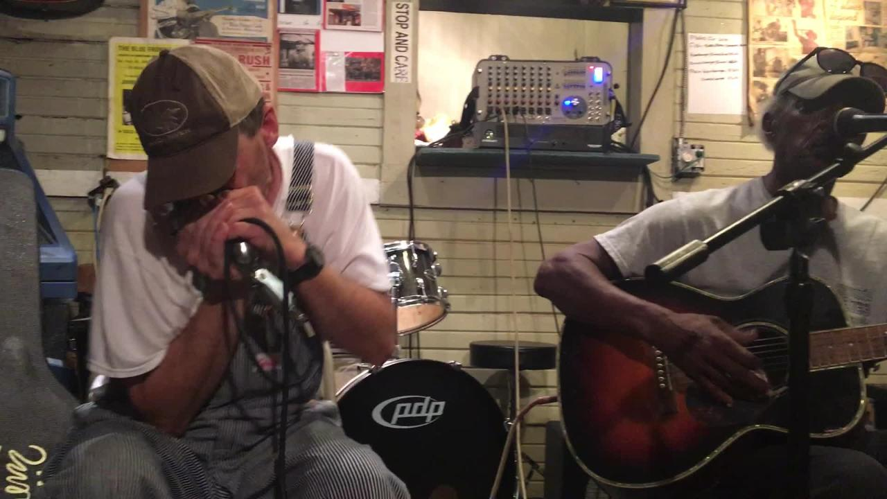 """Jimmy """"Duck"""" Holmes (center) performs with Minnesota musicians Dave Hundreiser (left) and Mike Munson at Holmes' juke joint, the Blue Front Cafe."""