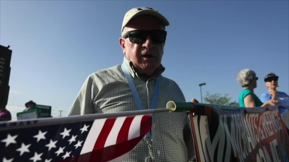 Retired priest spreads message: 'Immigrants and Refugees Welcome'