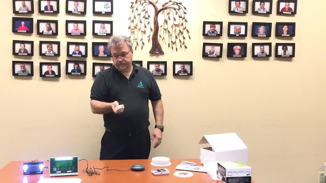 Hal Hunter-Suddreth, (deaf) community advocate with Tri-County GLAD, demonstrates how a fire and smoke alarm for the deaf and hard hearing work at Tri-County GLAD. The VCFD received a FEMA Grant to provide specialized smoke alarm kits for high risk communities including residents who are deaf.