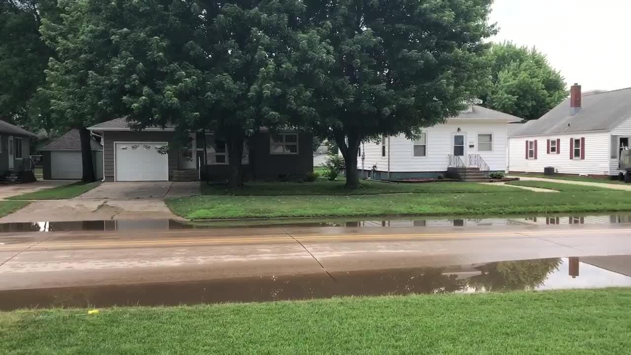 Floodwaters covered much of a residential street in Rock Valley, Iowa, on Friday, June 22, 2018.
