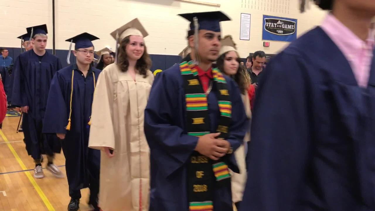 Beacon High School's class of 2018 walks into the school gym for their commencement ceremony on June 23, 2018.