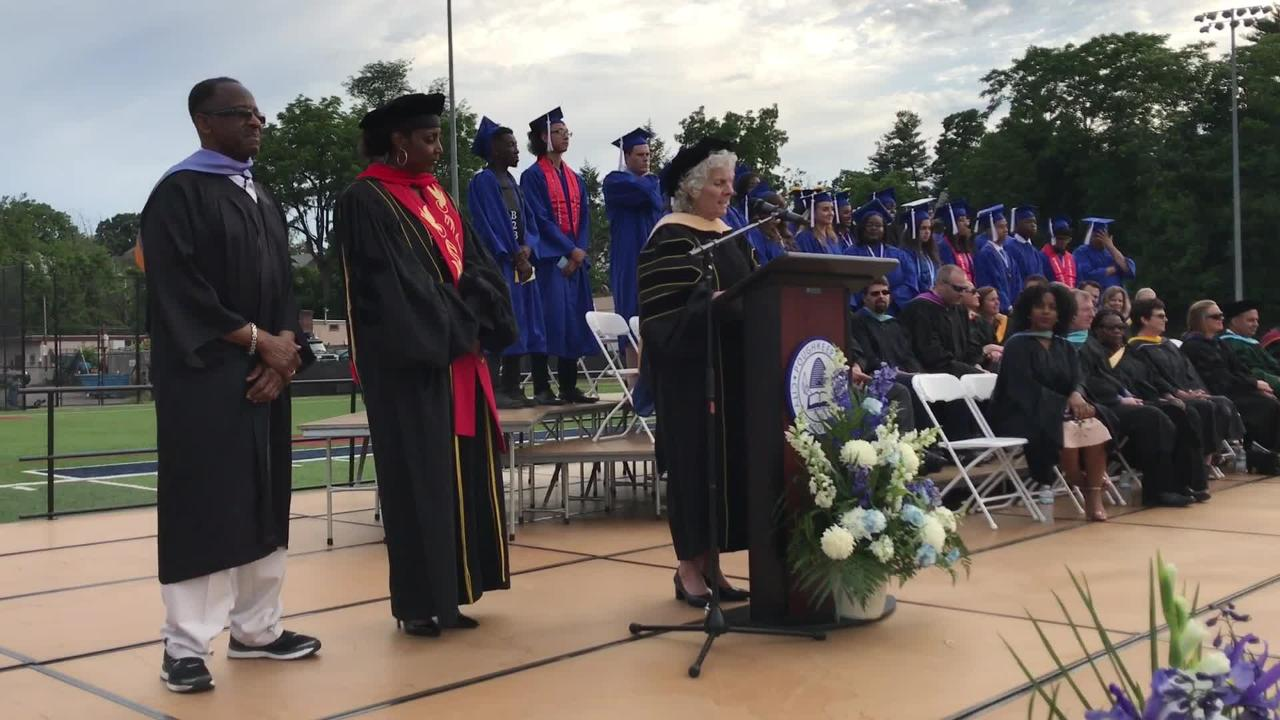 Deputy Superintendent Kathleen Farrell announces the Poughkeepsie High School class of 2018 during the commencement ceremony on June 22, 2018.