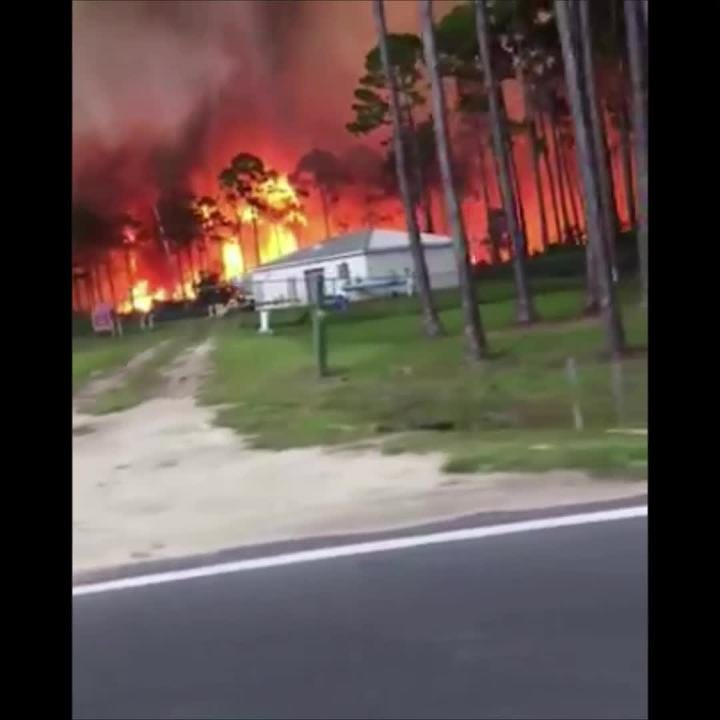 This video was taken through a car window, driving close to the Eastpoint fire.