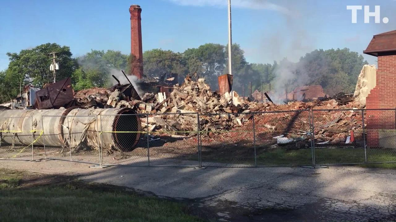As of Monday morning, smoke still blew off the remains of the Chicory Warehouse after a fire tore through the building.