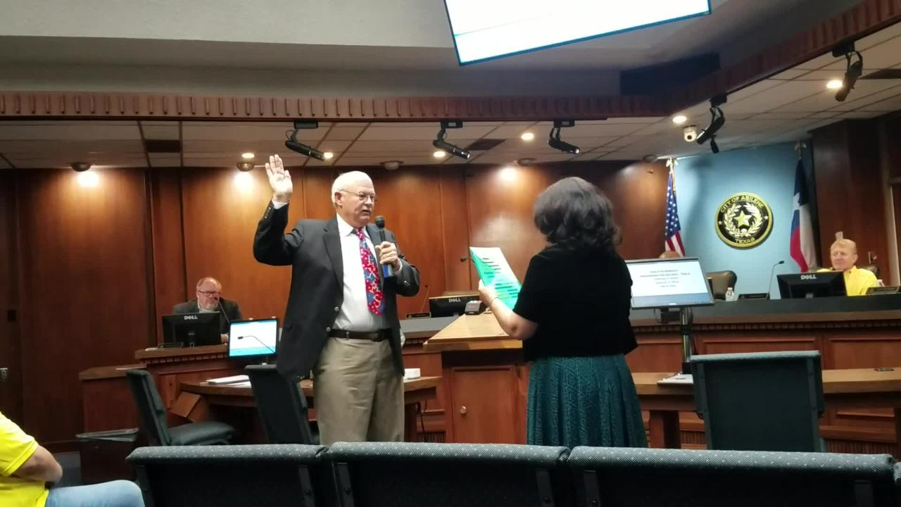 Incoming Abilene City Councilman Jack Rentz is sworn in for Place 2 by city secretary Rosa Rios.