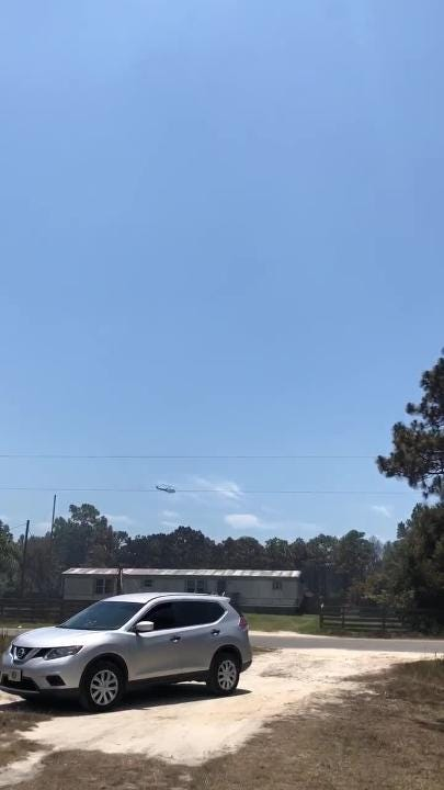 In video provided by Gulf County Fire Departments, a helicopter can be seen in the distance flying over the Eastpoint fire.