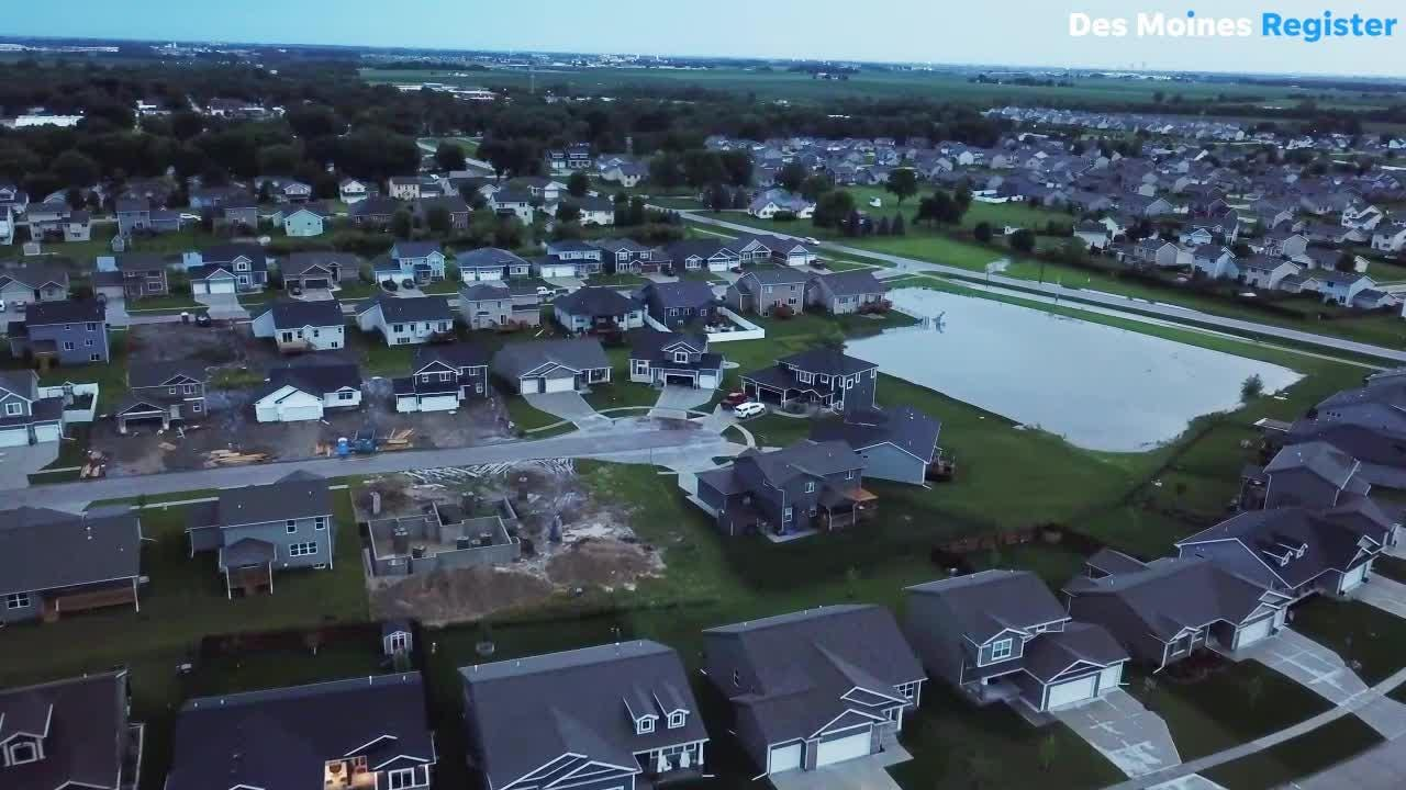 Drone video shot by resident Andy Ray shows neighbors cleaning Sunday after flooding hit homes around the area of Aspen Drive NE in Bondurant.