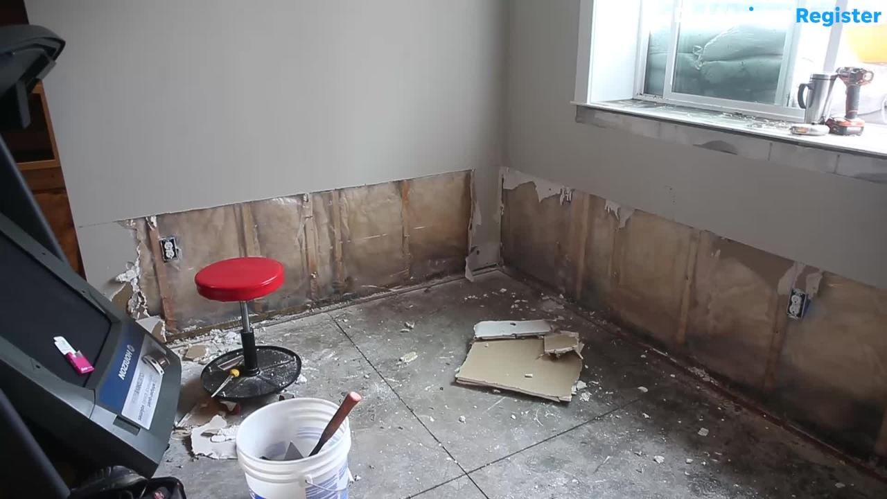 After heavy rain Sunday caused flooding in parts of Bondurant, some residents spent Monday cleaning up their basements.