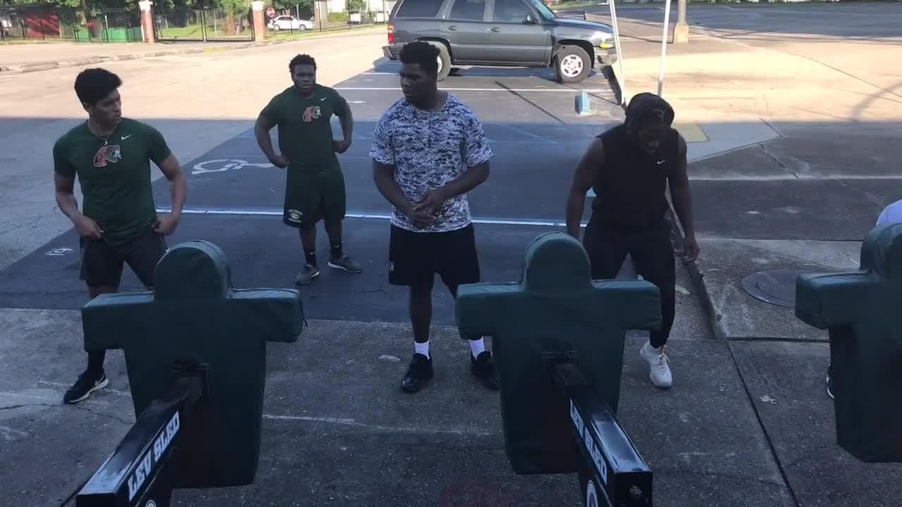 FAMU players work on their core balance while hitting the sled.