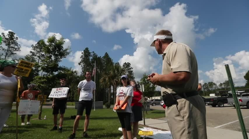 Wakulla County Undersheriff meets protestors outside ICE facility