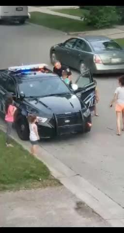 A Port Huron Police officer stopped and played with kids near 13th and Chesnut last week.