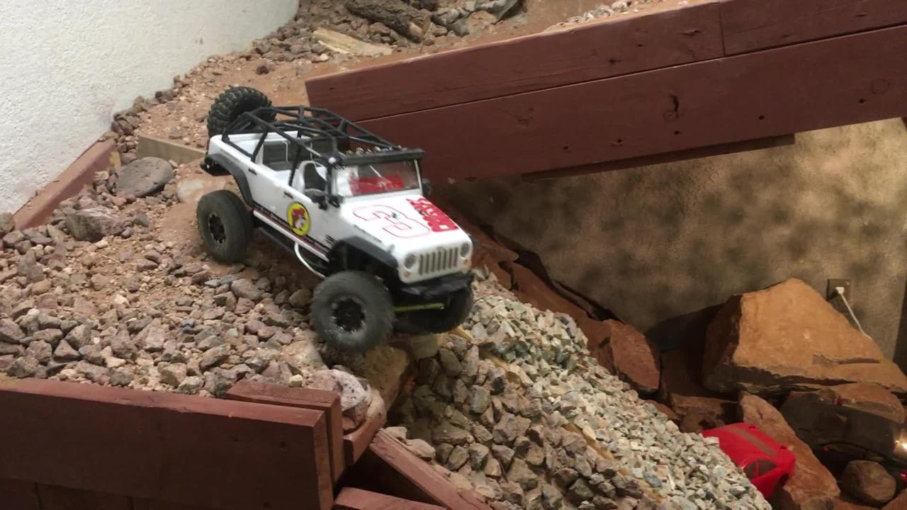 3 Crosses RC Racing and Repair co-owner Randall Garcia demonstrates the indoor rock-crawling track for RC trucks.