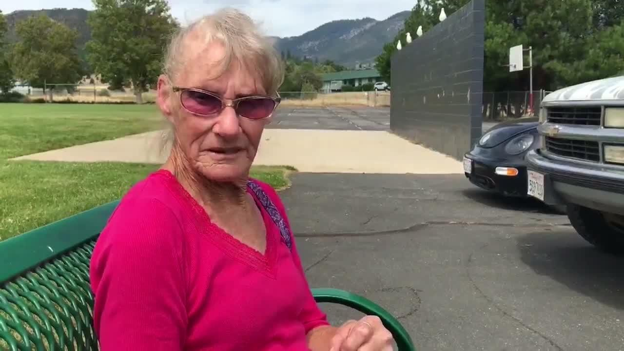 Barbara Taylor' home of 40 years was destroyed in the Klamathon Fire. She sits outside the evacuation center in Yreka.