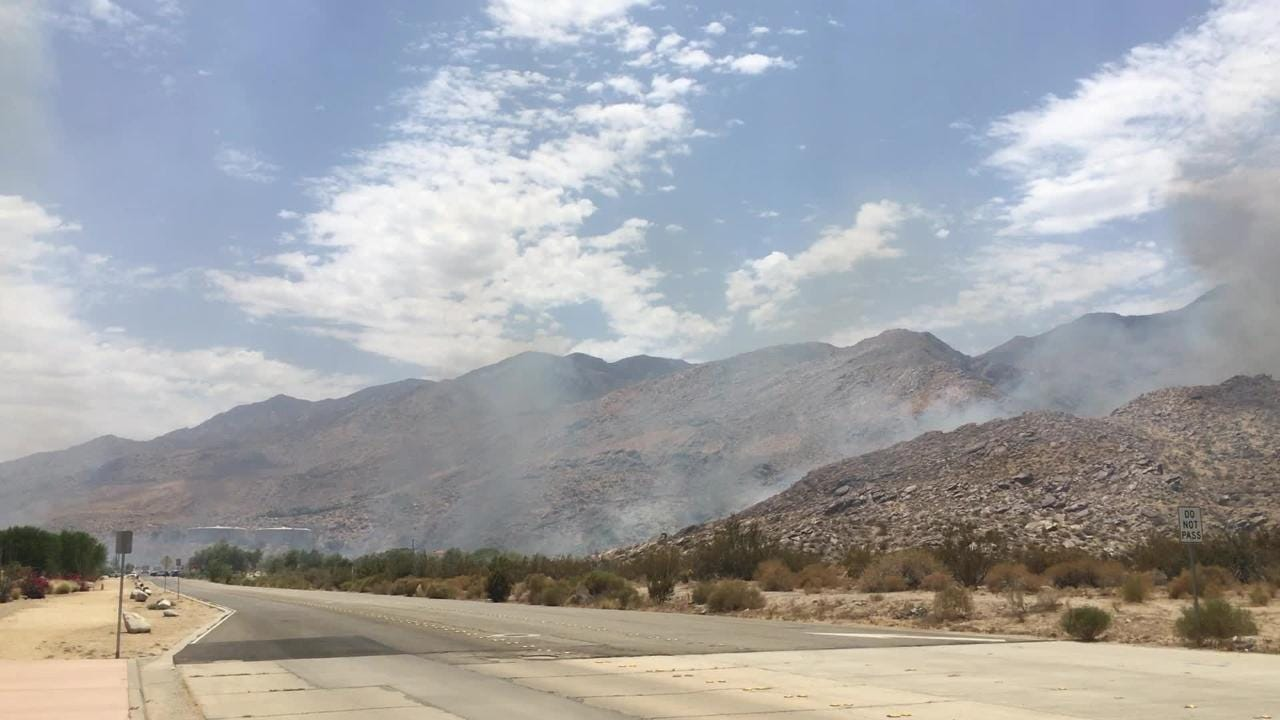 A brush fire broke out near South Palm Canyon and Acanto drives in Palm Springs, Friday, July 6, 2018.