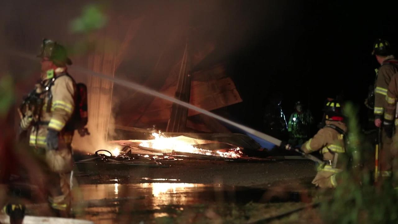 A fire engulfs a shed at a Pennsylvania golf course.