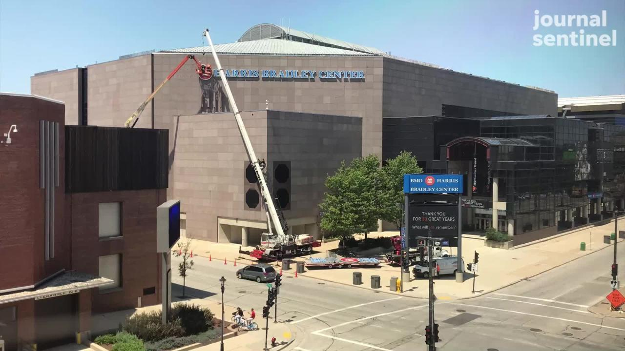 Workers began removing the BMO Harris Bradley Center signs.