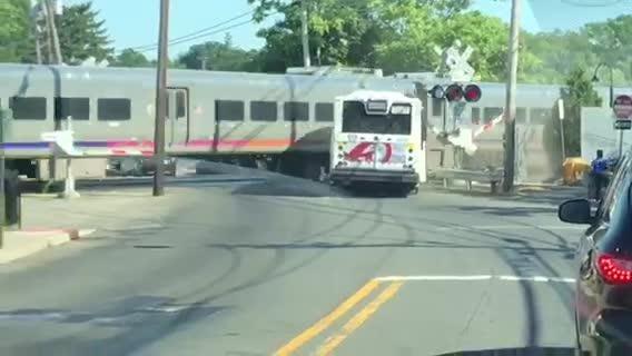 NJ Transit train hits bus in Garfield: Video