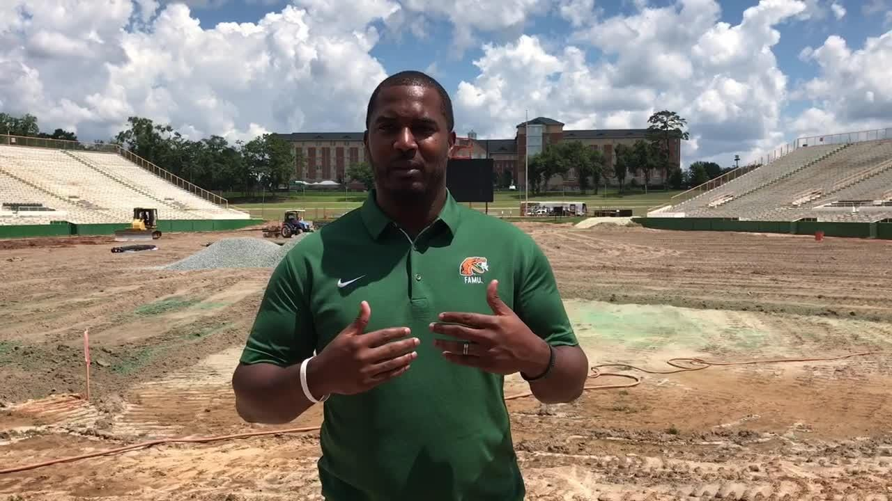Football coach Willie Simmons discusses the joy shared by players and alumni on the field turf installation at Bragg Memorial Stadium