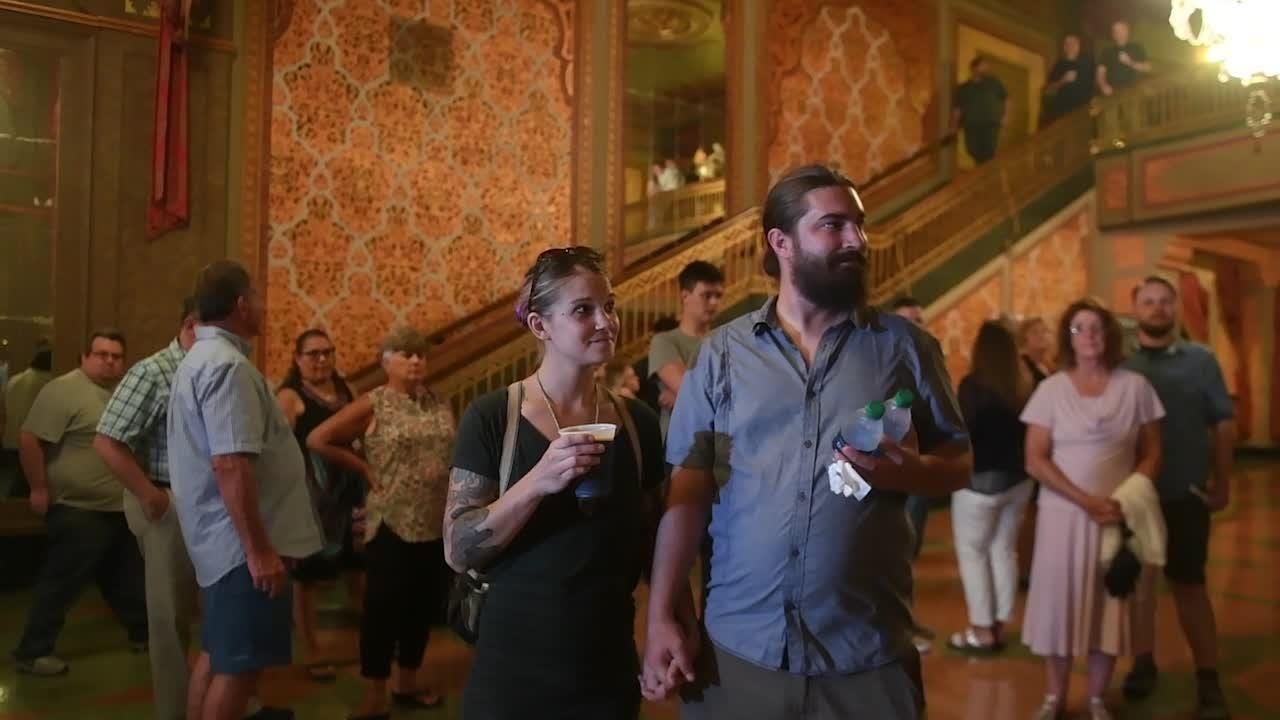 Emily and Sam Brouse are surprised as Tennessee's Theatre's 2 millionth visitor
