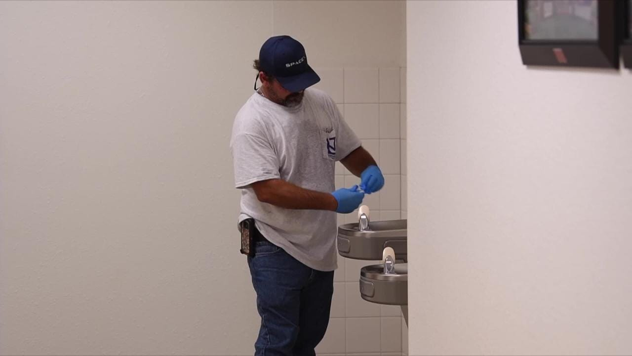 Technicians from Universal Engineering Sciences tested the tap water at barrier island schools on Wednesday.