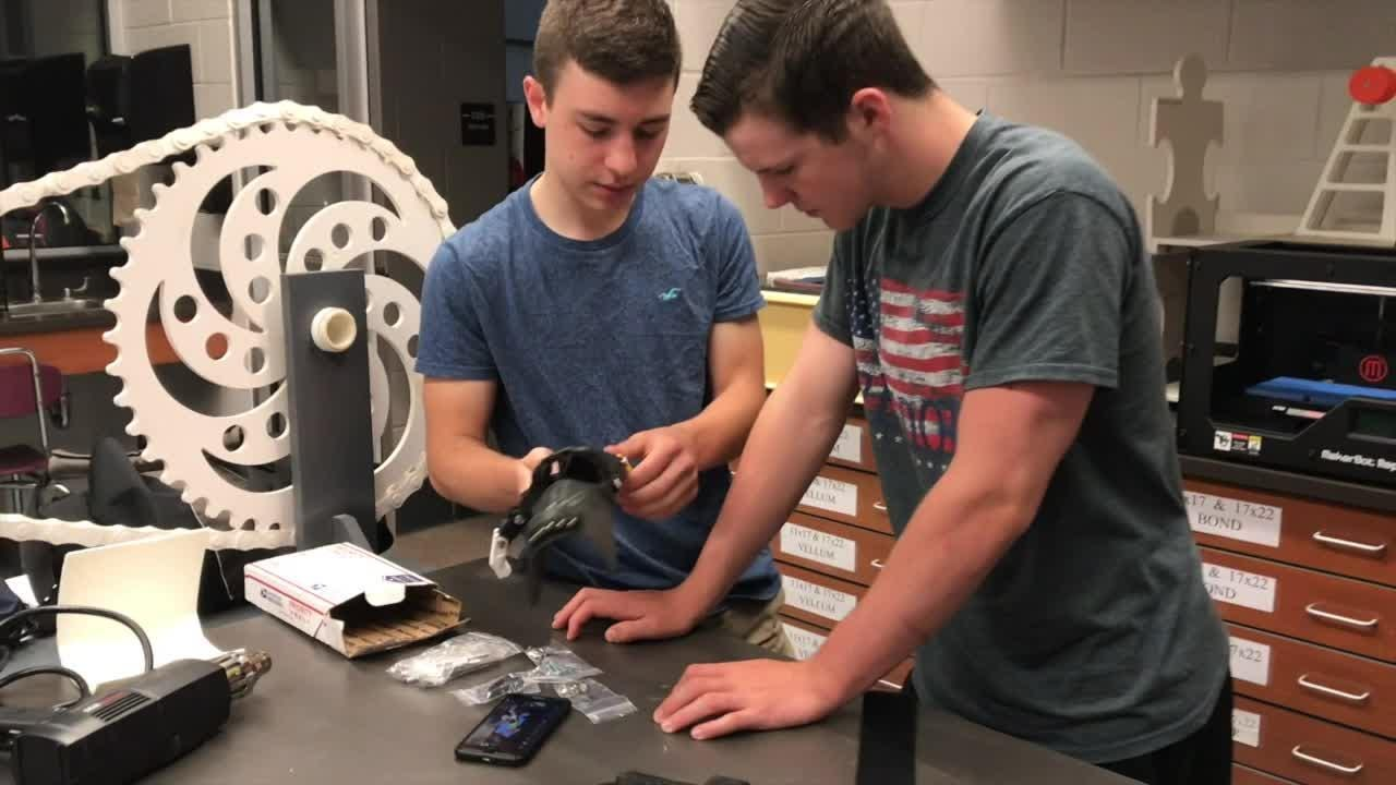 A video of Gettysburg High School students fitting a free 3D-printed hand for an amputee went viral on Facebook on July 9.