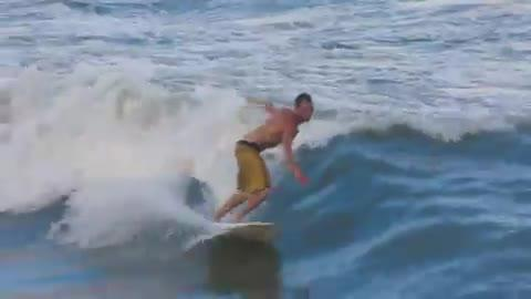 Bobby Baughman was bitten by a shark in December, but that hasn't stopped him from surfing. Posted Oct. 2016.