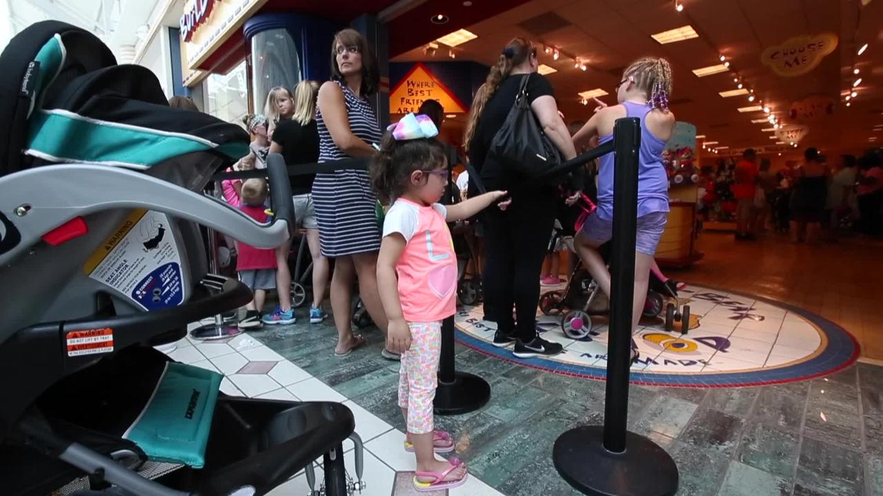 Customers wait in line to enter Build-A-Bear Workshop at Eastview Mall. Video by Carlos Ortiz.