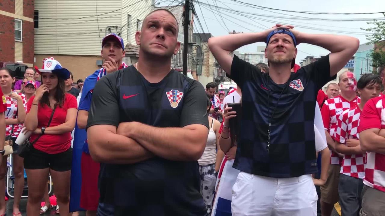Croatian soccer fans watch the World Cup finals during a block party on Walker St. in Fairview. Croatia lost to France 4-2 in the finals.