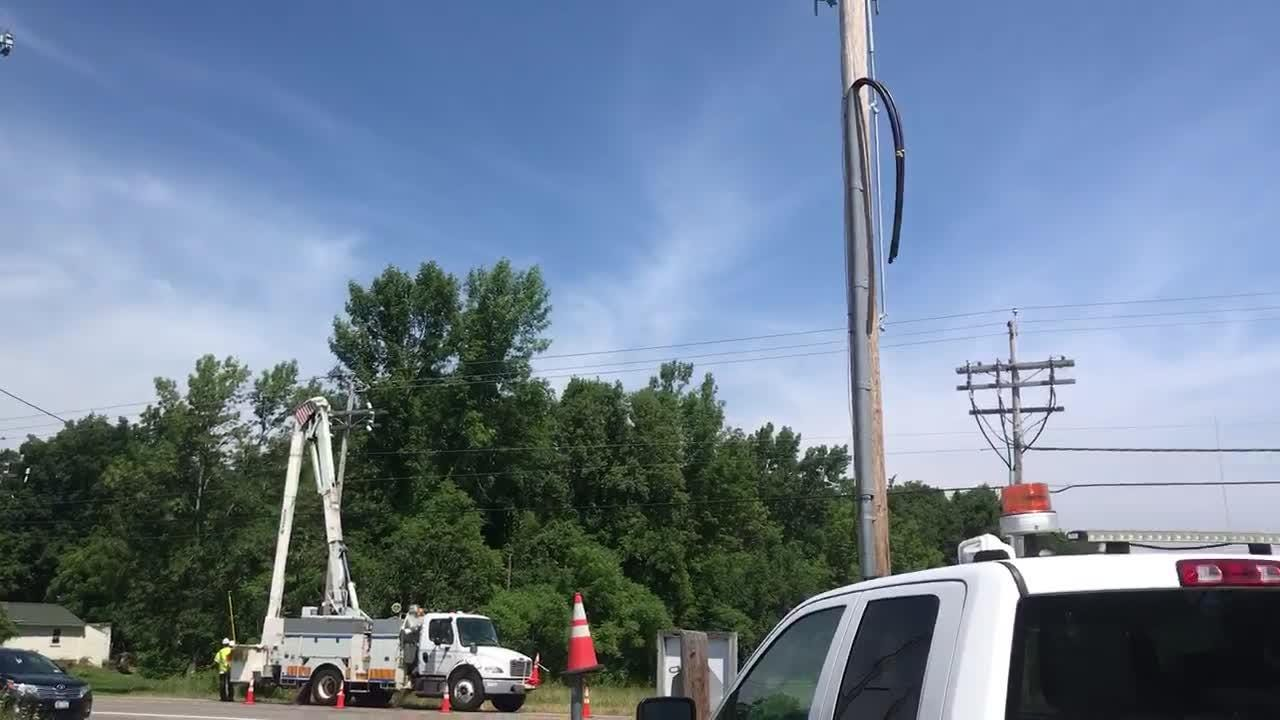 National Grid says a wooden pole that had burned and fallen in a wooded area was the source of Monday's power outages in Monroe and Orleans counties.