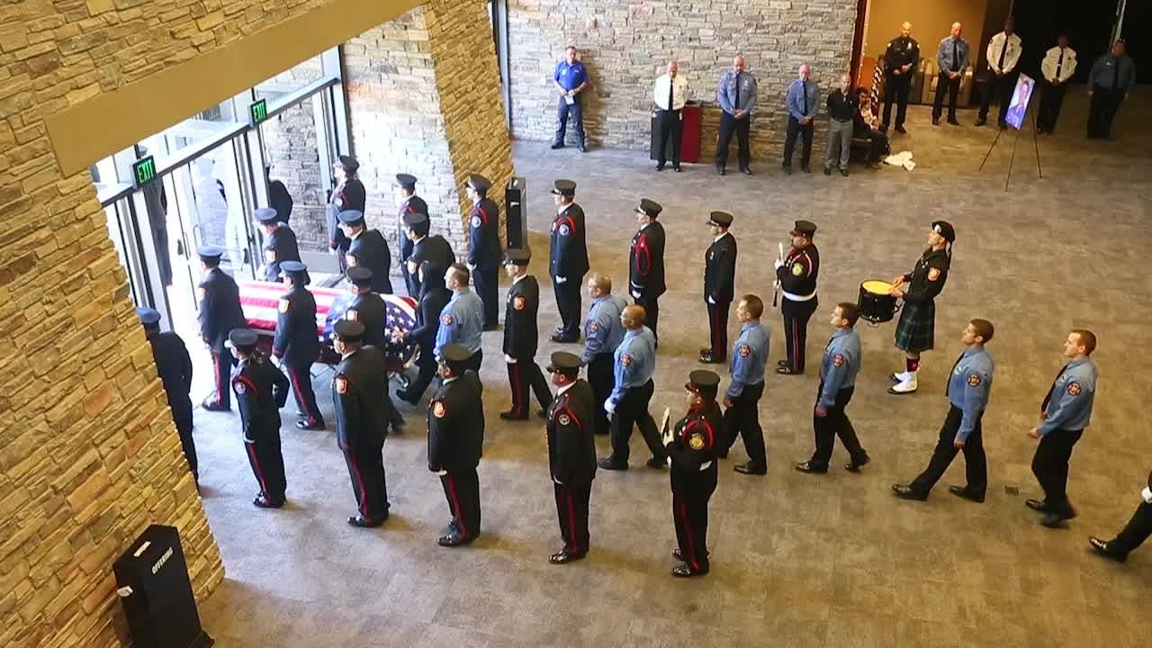 The flag draped casket is carried during the recessional of the funeral service for Juston Dae Doherty.