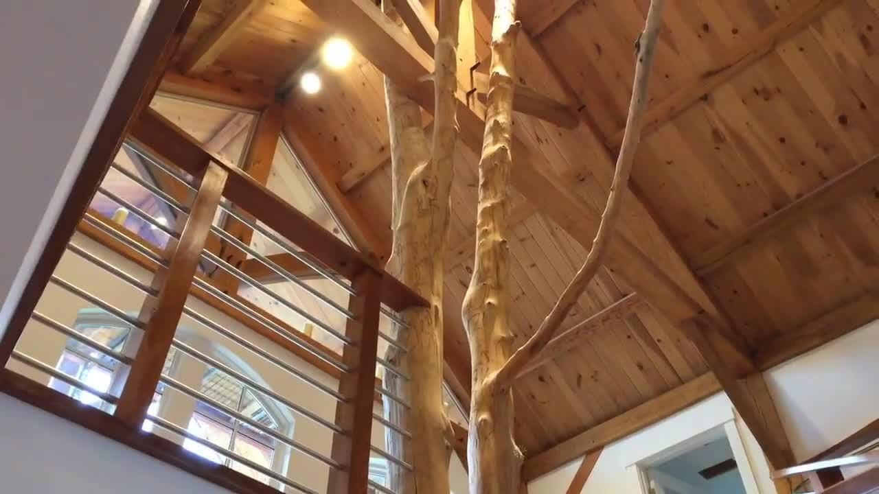 Paul Kaplan gives a tour of his unique modern house within a barn, built-from-scratch home that features a spiral staircase built using a tree.