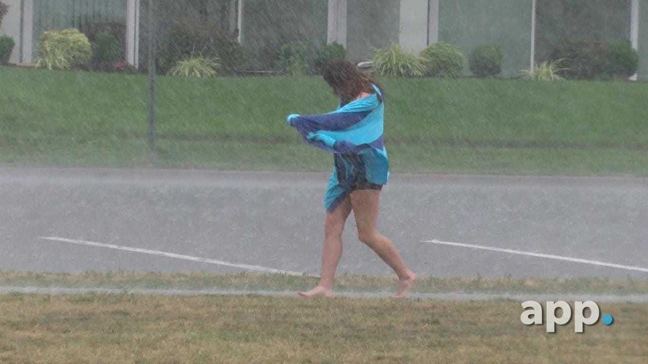 People around the Taylor Pavilion in Belmar get caught in Tuesday afternoons downpour.