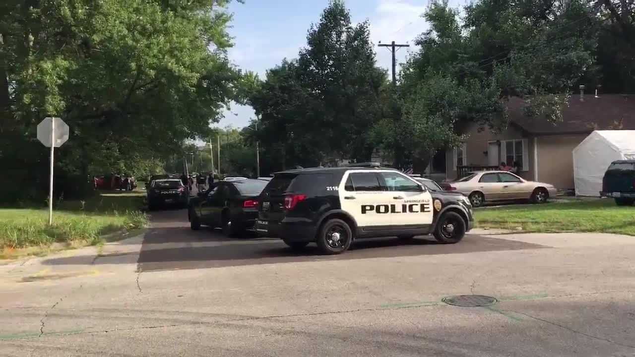 Police blocked off two streets blocked in northwest Springfield on Wednesday evening, July 18, 2018, as they search for a suspect in a parole violation.