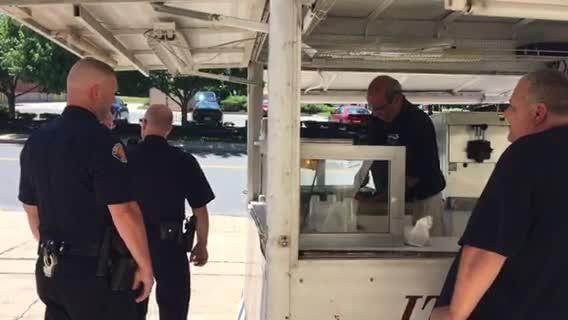 Lebanon city workers enjoy free Sirro's Italian ice on a warm summer day.