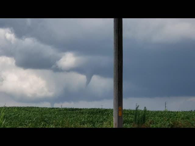 A funnel cloud is visible in central Iowa on Thursday, July 19, 2018. The view is northeast from Altoona, toward Bondurant.