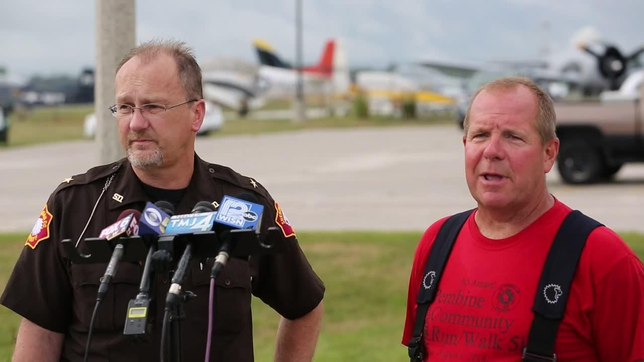 Sheriff Cory Roeseler briefs the media on a plane crash off County Road O near the Sheboygan County Memorial Airport.