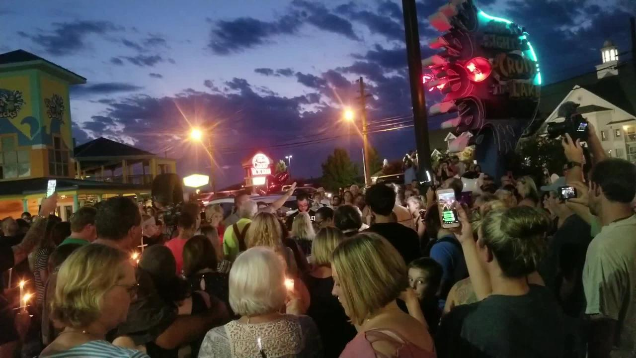 Branson community members and tourists come together for candlelight vigil after a boat capsized and killed 17 people on July 19.
