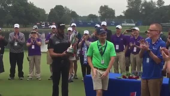 Troy Merritt receives his trophy from the 2018 Barbasol Championship