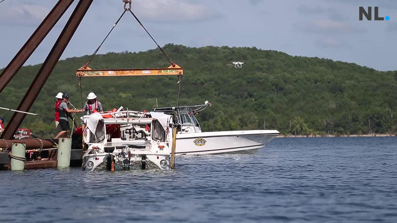A salvage crew used a barge-mounted crane to raise the Ride the Ducks boat from the bottom of Table Rock Lake.
