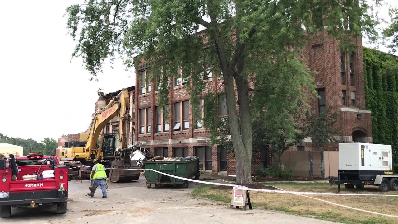 Crews began work to demolish the former Dansville Middle School on Monday, July 23, 2018, in Dansville.