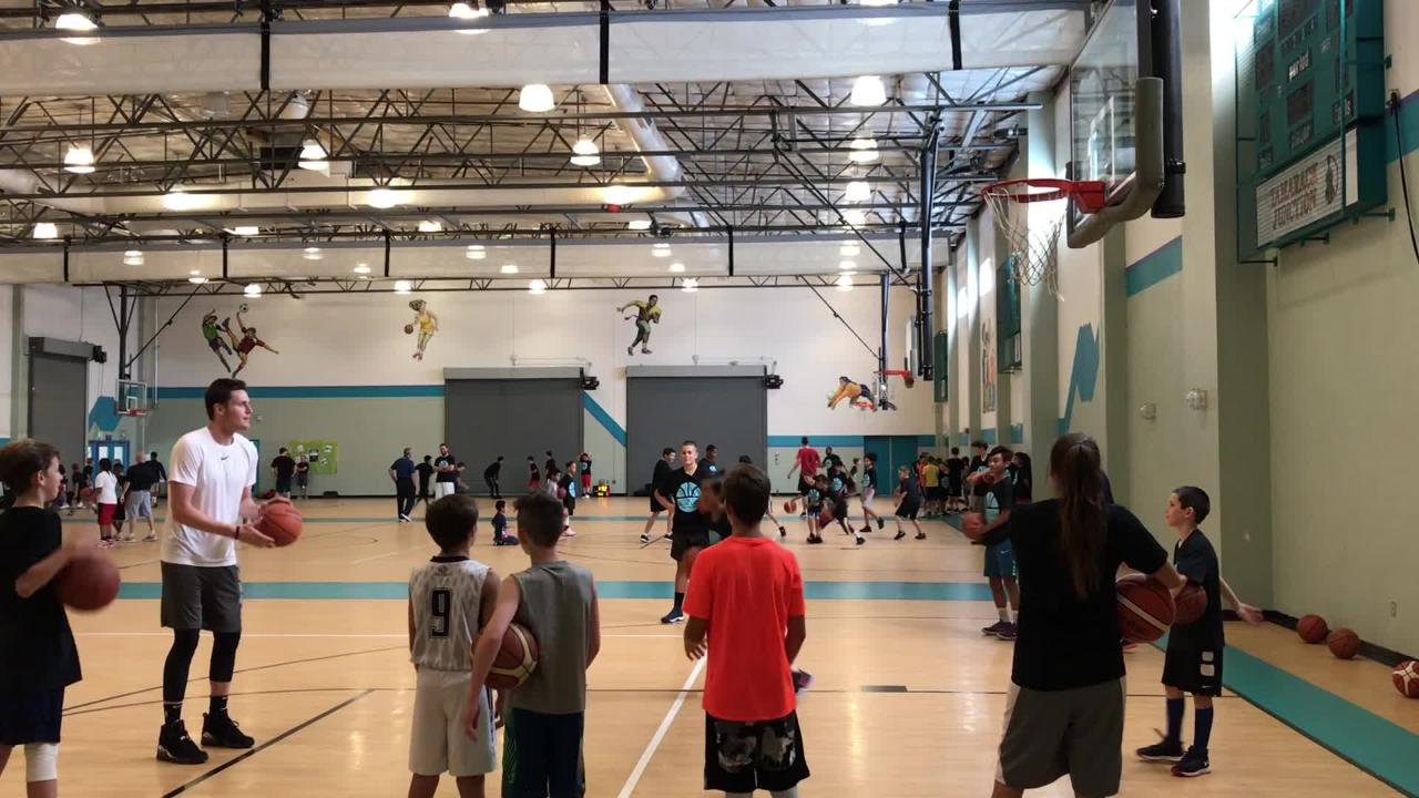 Ex-Wolf Pack star and current NBA player Luke Babbitt wages (and wins) a free throw contest with a school kid at the Tristan Hill Blue Chip Camp.