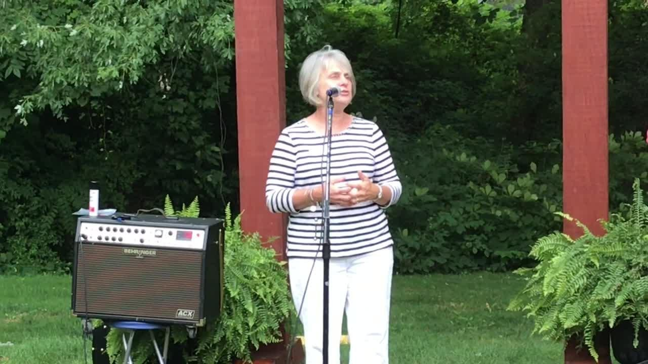 America in Bloom judge Susie Stratton talks about Coshocton floral displays at a reception Tuesday at Clary Gardens.