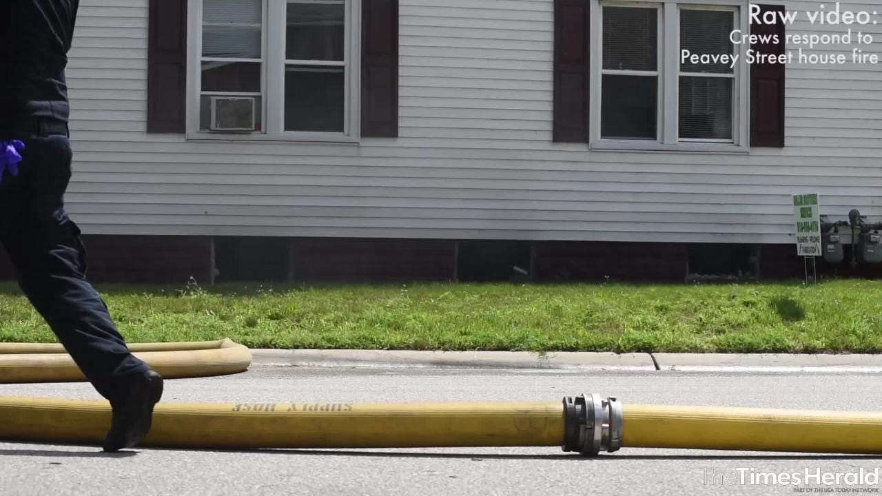 Rescue crews respond to a house fire Wednesday on Peavey Street in Port Huron.