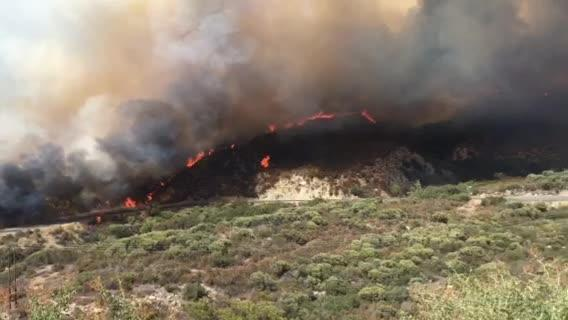 A fast-moving wildfire Wednesday afternoon is forcing evacuations in the San Jacinto Mountains in an area southwest of Idyllwild, authorities said.