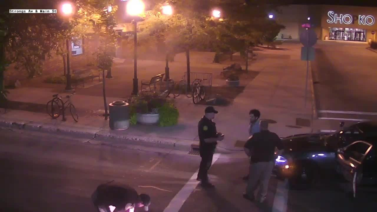 Security camera footage shows police question Deandre Pettiford-Bates on Main Street in Stevens Point, Wis., in the early morning of July 23, 2018.
