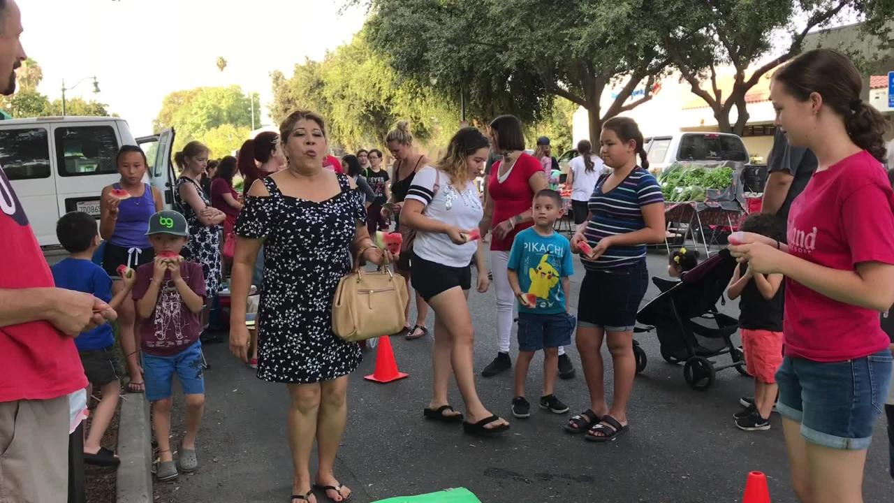 People shopping in downtown Visalia or at the Thursday farmers market picked up their watermelon slice and spit a seed as far as they could.